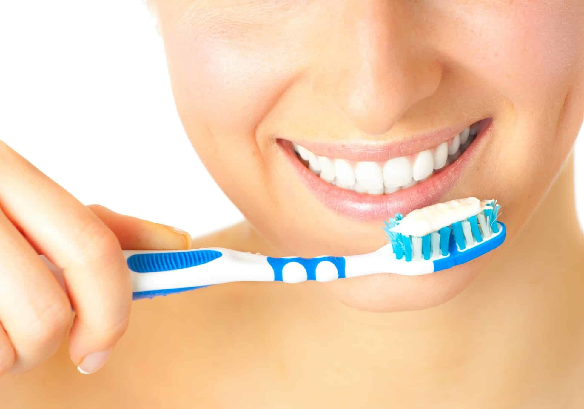Woman healthy teeth closeup brushing concept
